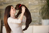 Pretty brunette kissing her dog