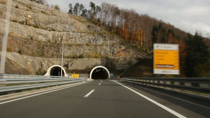 Car driving highway and through tunnel