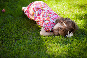 Little girl relaxing in a park