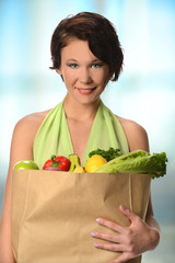 Young Woman Carrying Bag of Groceries