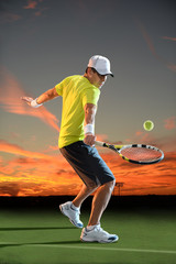 Man Playing Tennis at Sunset