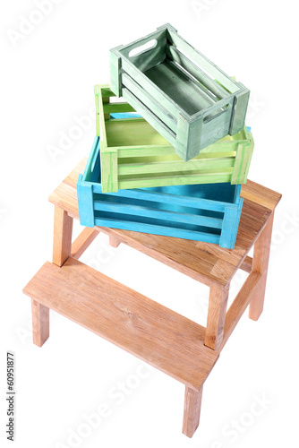Empty wooden boxes on small ladder, isolated on white