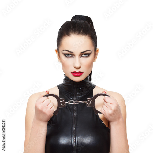 Sexy dominatrix with handcuffs