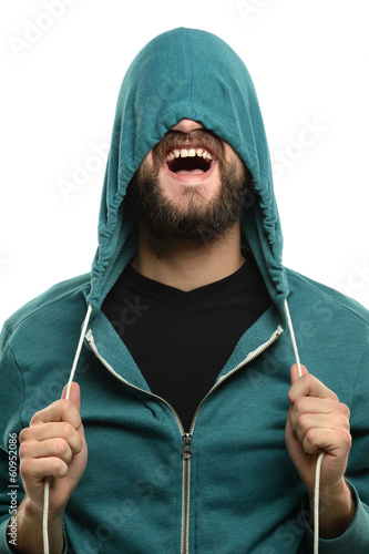 Young Man Pulling Hooded Jacket Over Head