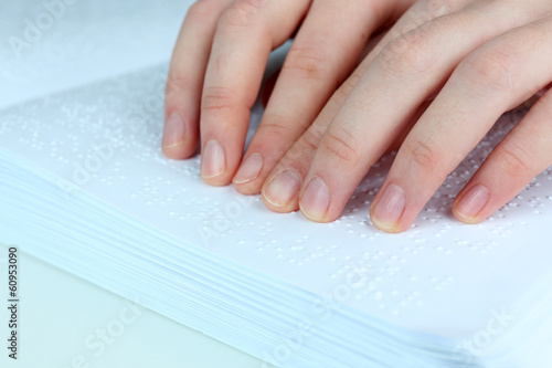 Blind woman read book written in Braille