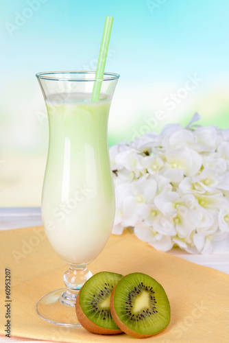 Milk shake on table on light blue background