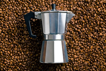 coffee maker on coffee beans