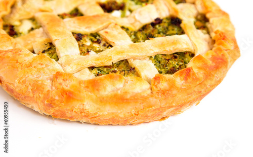 Vegetables pie with ricotta on white background