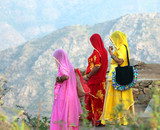 Fototapety Indian women in colorful saris on top of hill