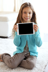 Child playing on tablet pc
