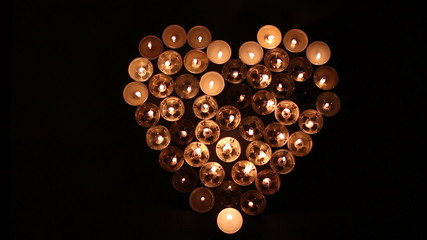 Heart shape made of candles