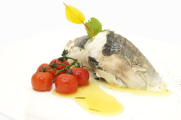 Baked fish fillets in the form of rolls with cherry tomatoes