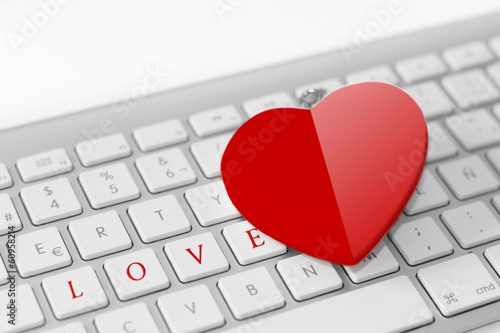 Red heart on keyboard. Love concept