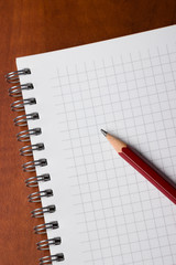 Notepad and pencil on desk