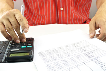 Man calculating interest rate of lottery for saving