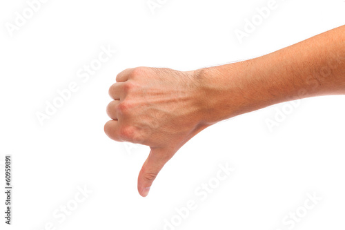 Thumb down male hand sign isolated on white