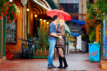 couple in love kissing under the rain
