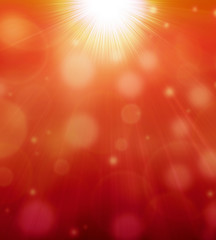 abstract bokeh background with warm sunrays
