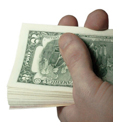 Mans hand holding a stacks of paper dollars USA on the white bac