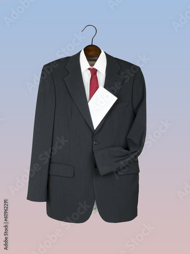 Business jacket, shirt and tie on wooden hanger with envelope