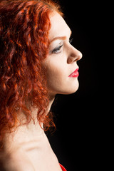 Beautiful girl with curly red hair