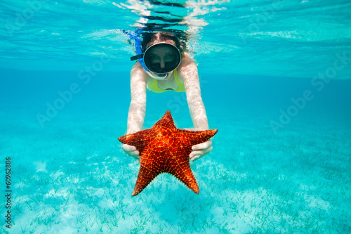 Young woman holding a giant starfish