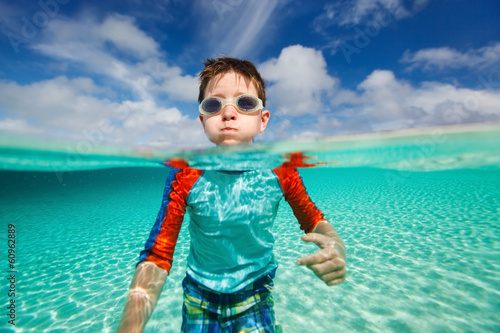 Little boy swimming in ocean