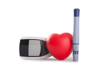 red heart with blood glucose meter
