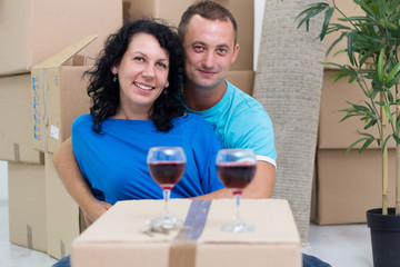 couple in their new home with cardboard boxes