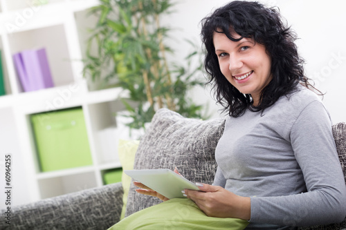 young woman in  home using digital tablet