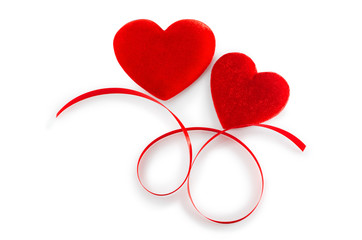 Two Red  Hearts  with red ribbon isolated on white (with path).