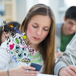 Student using mobile technology to communicate