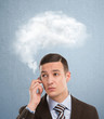 Businessman and a cloud of thoughts on a blue background