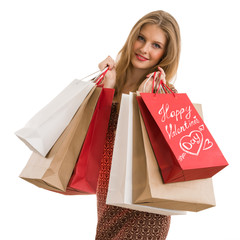 Shopping woman holding shopping bags looking at camera