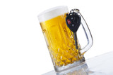 A glass of beer and car keys