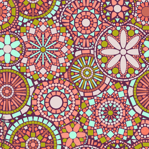 Colorful circle flower mandalas seamless pattern in pink, green