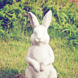 Statue of rabbit in the garden with retro filter effect