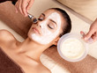 Leinwandbild Motiv Spa therapy for woman receiving facial mask