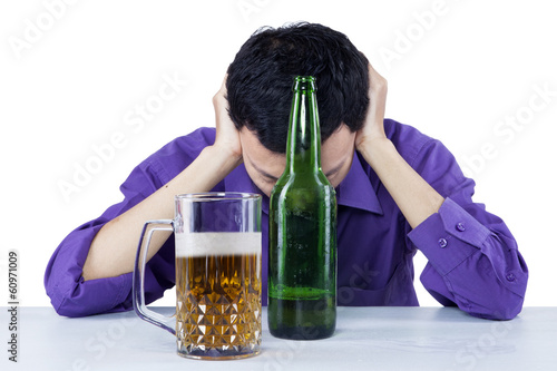 Sad drunk businessman with beer