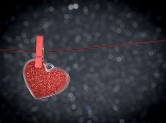 decorative red heart hanging on dark bokeh background