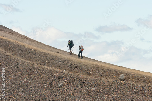 isolated tourists on volcanic slope