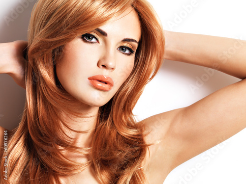Beautiful woman with long straight red hair