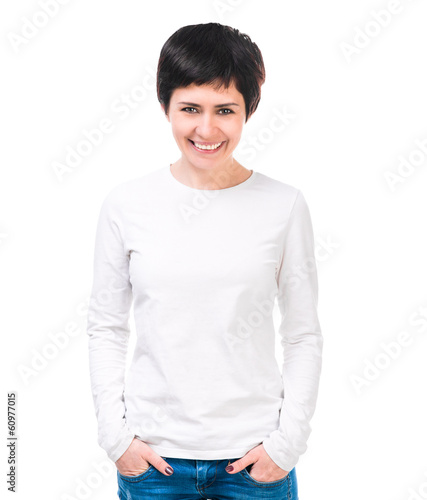 Smiling brunette woman in white blouse and jeans