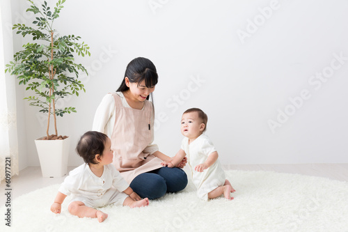 asian babys and mother in the room
