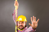 Young construction man withhard hat wearing  a fall protection h