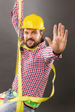 Young construction man with hard hat wearing  a fall protection