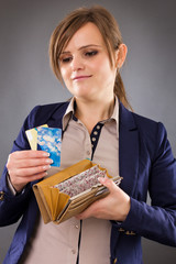 Portrait of a smiling businesswoman holding her wallet and credi