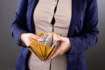 Closeup portrait of a businesswoman looking at an empty wallet