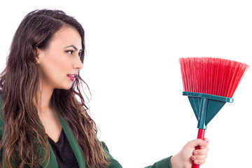 Beautiful young woman holding a broom