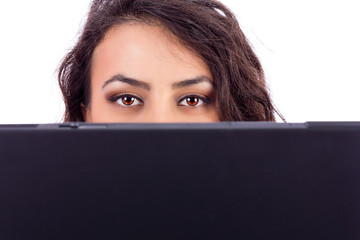 Young businesswoman holding a laptop in front of her face, can o